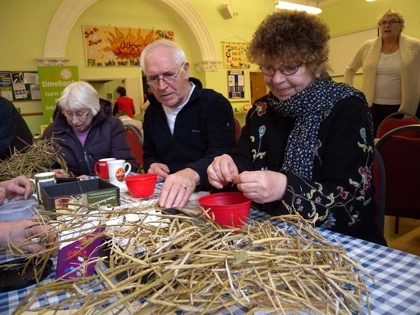 Winnie, Owen and Carol saving seeds for Seedy Saturday
